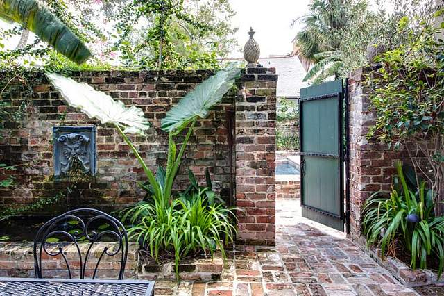 Courtyard of romantic Audubon Cottages in New Orleans