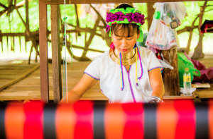 A Karen tribeswoman weaving in northern Thailand
