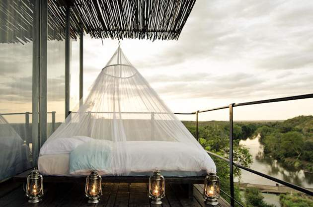 outdoor bed at Singita Lebombo on a safari honeymoon