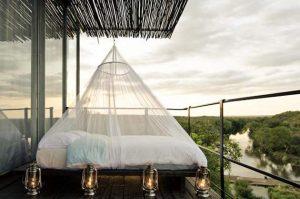 outdoor bed at Singita Lebombo on a safari honeymoon